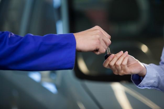 mechanic-giving-keys-customer_1170-1432
